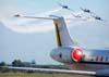 Os Embraer EMB-312 Tucano números 1, 2, 3 e 4, designados pela Força Aérea Brasileira como T-27, do EDA (Esquadrão de Demonstração Aérea), conhecido popularmente como Esquadrilha da Fumaça, passando atrás da cauda do Embraer ERJ-145 ER, C-99A, FAB 2524, da Força Aérea Brasileira, que operou na Rio-Sul com o prefixo PT-SPF, onde era apelidado de JetClass.