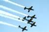 """Os Embraer EMB-312 Tucano números 1, 2, 3, 4, 5 e 6, designados pela Força Aérea Brasileira como T-27, do EDA (Esquadrão de Demonstração Aérea), conhecido popularmente como Esquadrilha da Fumaça, realizando um """"espelhão""""."""