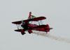 Wingwalker Marta Bognar voando na asa do Boeing A75N1 Stearman, PT-ZST, pilotado por Ricardo Beltran Crespo. (12/05/2012)