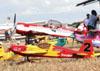 Em primeiro plano, três aeromodelos, e posteriormente, o Sukhoi SU-31 de Luís Guilherme Richieri e o Grumman Show Cat de Pedrinho Melo e Marta Bognar. Foto: Carlos Patrício.